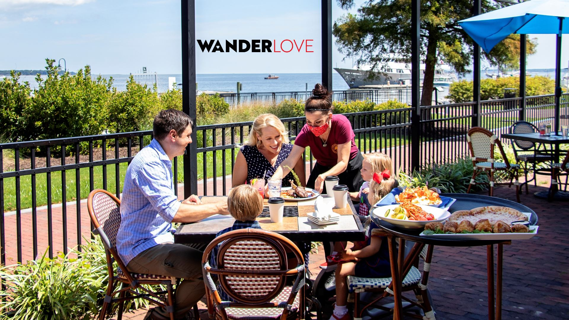 Family dining on the patio of Water Street Grille