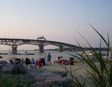 People lounge on the Yorktown Beach.