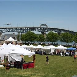 Pan of Artist Tents with Bridge in Background